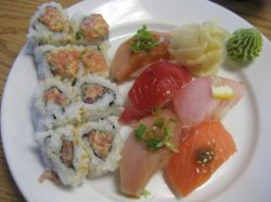 The combination includes soup or salad, a cut roll (8 pieces) and five pieces of sushi.