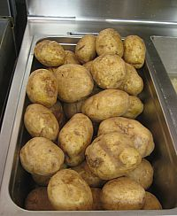 Just washed fresh potatoes ready to be prepared for fries.  Photo: Karen Young