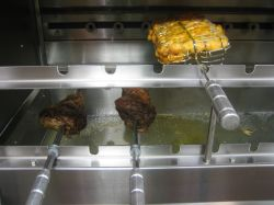 Meat and chicken is marinated for 24 hours before being roasted on this spin grill. Photo: Karen Young