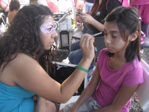 Paul Mitchell The School students painted faces, styled hair and helped with dress up.