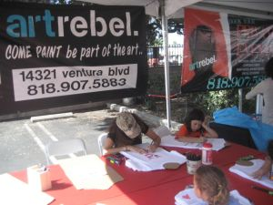 Painting and spin art at the Art Rebel booth.