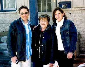 Dave Koz and Roberta Koz Wilson with their mother, Audrey, in front of the house she grew in in Manitoba, Canada.