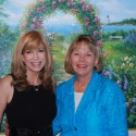 Leeza Gibbons and artist Susan stand in front of Rio's original painting created especially for Circle of Care, which will now be the art used on the newly launched merchandise line, A Caregiver's Oasis, to benefit Circle of Care Leeza's Place.