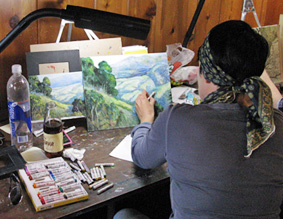 Lisi Grinstein completing her mixed media of watercolors and oil pastels.