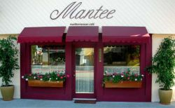 Mantee Cafe is just east of Vineland. Free parking in back. BYOB and no corkage!