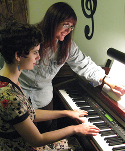 Emma and Linda at the piano.
