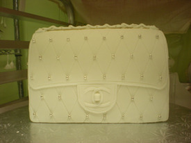 This cake is designed like a Chanel clutch handbag. Photo: Carole Rosner
