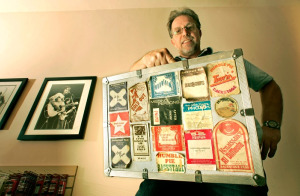 Greg Papazian with his camera case covered with concert passes.  Photos: Courtesy Greg Papazian