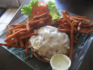 1/2 pound Kobe burger with tomato, lettuce, carmelized onion and herb aioli ($8.25) with sweet potato fries.