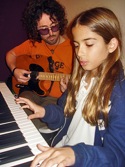 """Mark """"Muddy"""" Dutton, Music Director Rock Nation, with student, Kailey. Photo: Courtesy Rock Nation"""