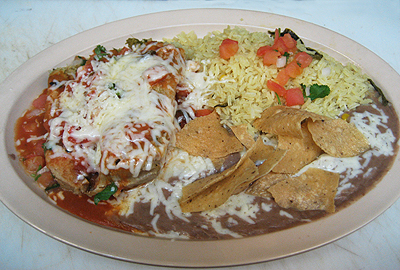 The tamale plate includes one chicken (pictured) or beef homemade tamale topped with pico de gallo, mild salsa and jack cheese. All combination plates are served with rice and beans.