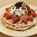 Forget Me Not Pancakes: strawberries, macadamia nuts, chocolate chip buttermilk pancakes with whip cream. Photos: