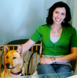 Green Graphics and Printing owner, Renee Delgado with her dog Maggy.