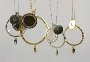 Necklace with an optical lens for magnifying.