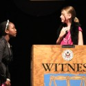 Sixth Grader Sydney Lane, questions classmate Molly Lumsden during Laurencne School&#039;s Kid&#039;s Court Trial of Dr. Frank N. Stein.  (photo by Cliff Kramer, Nathanson&#039;s Photography)