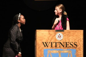 Sixth Grader Sydney Lane, questions classmate Molly Lumsden during Laurencne School's Kid's Court Trial of Dr. Frank N. Stein.  (photo by Cliff Kramer, Nathanson's Photography)
