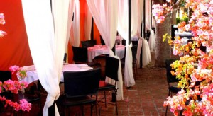 Reserve a cabana on Ca Del Sole's patio for a romantic evening out.
