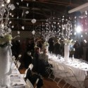 The theme of the December dinner was Winter Wonderland. Here guests mingle before dinner with appetizers and drinks.