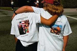 Two young children walk in memory of their mothers.  Photo: Our House