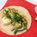 Rajas con Elote y Queso/ Roasted Poblano, Fresh Corn and Cheese (Photo Attached) Strips of Roasted Poblano Peppers simmered with onions, fresh white corn, Oaxaca cheese and Crema Mexicana. Garnished with Epazote Chiffonade.